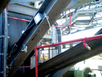 Temperature scanner mounted on conveyor structure